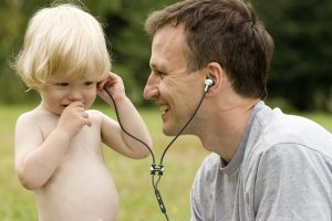 Father and Son with vest headset