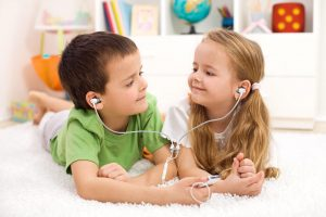 Two kids with vest headsets